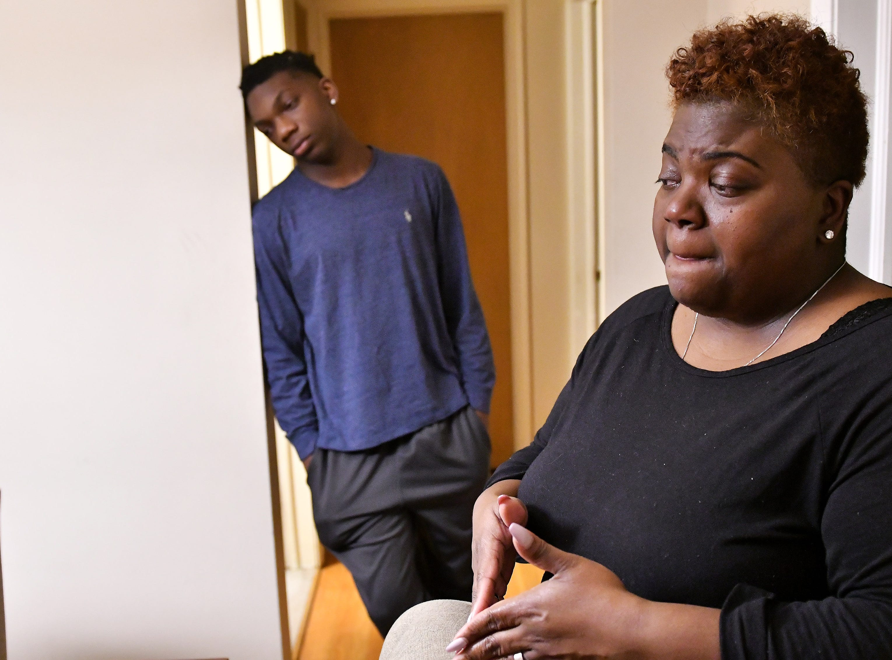 Deidra Harris-Thomas talks about gun violence and the death of her son, Corey Harris-Thomas, 17, at her home in Harper Woods on March 5, 2018. At left is her youngest son, Chris, 15. Another son, Corey Harris-Thomas, was shot and killed in June 2017 while attempting to sell a pair of Air Jordans.
