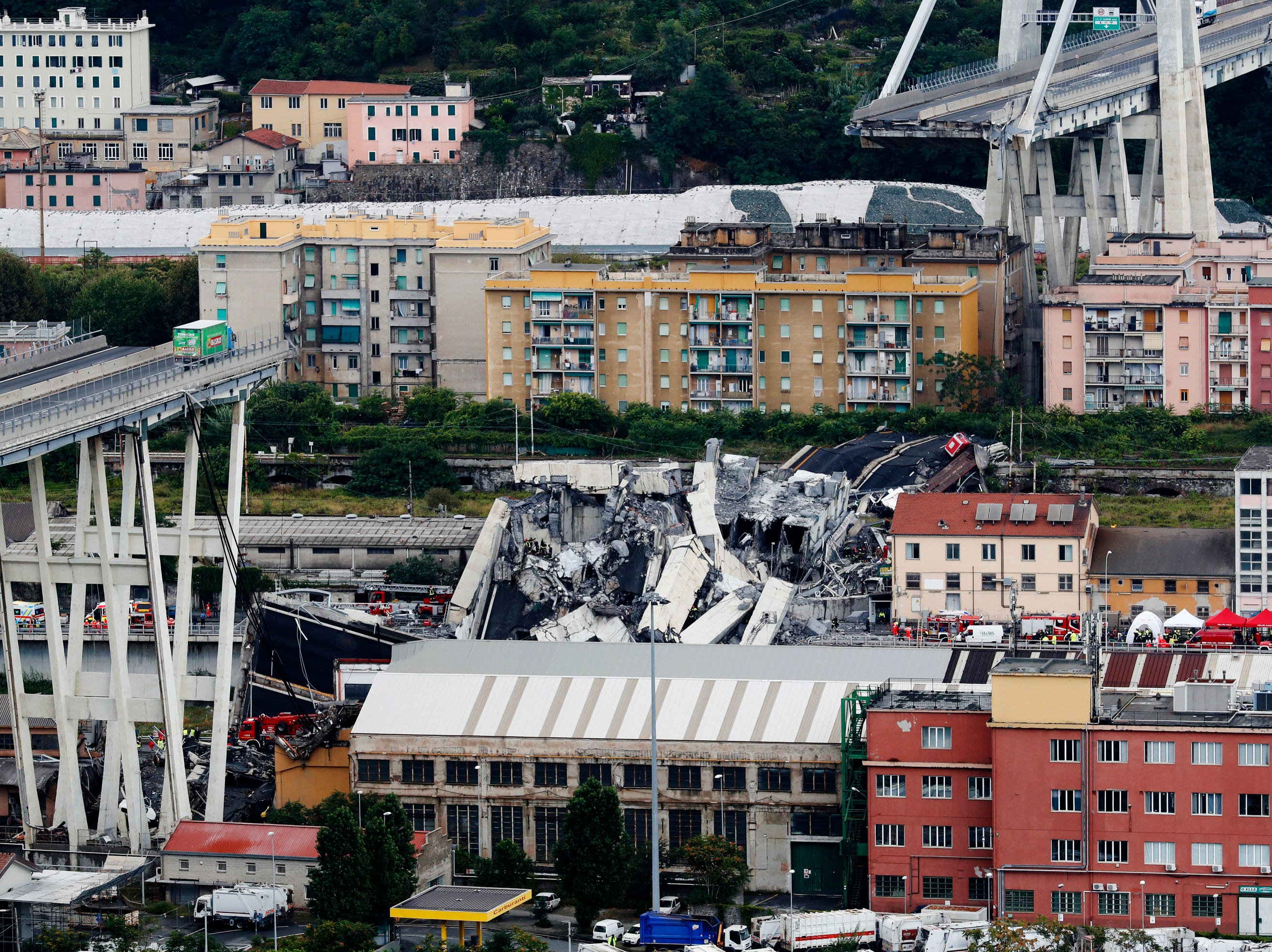 Cars are blocked on the Morandi highway bridge after a large section of it collapsed in Genoa, Italy, on Aug. 14, 2018, during a sudden and violent storm.