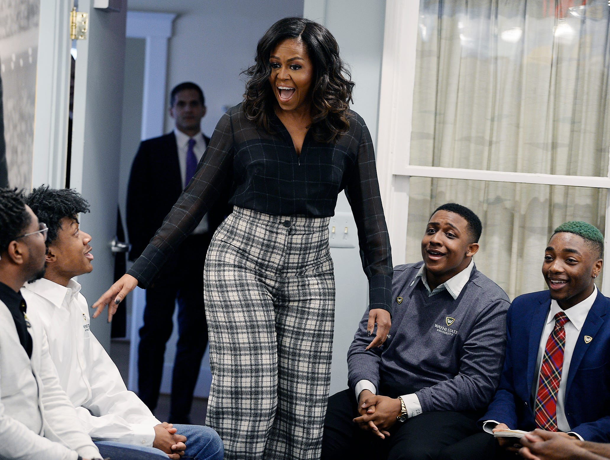 Michelle Obama, in town for her book tour stop at Little Caesars Arena December 11, 2018, surprised 18 Wayne State University students at the Motown Museum by joining a discussion about the challenges young men of color face in Detroit.