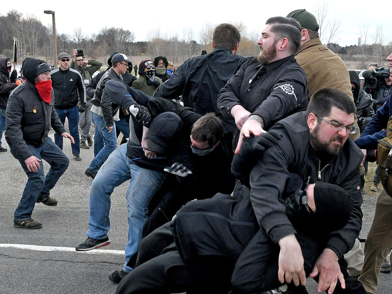 Protesters clash with supporters of white supremacist Richard Spencer outside the MSU Pavilion where Spencer was speaking on March 6, 2018.  At right, Matthew Heimbach, the leader of the Traditional Workers Party, throws an anti-Richard Spencer protester to the ground. Three MSU police officers and one state trooper were injured, and 25 people were arrested.