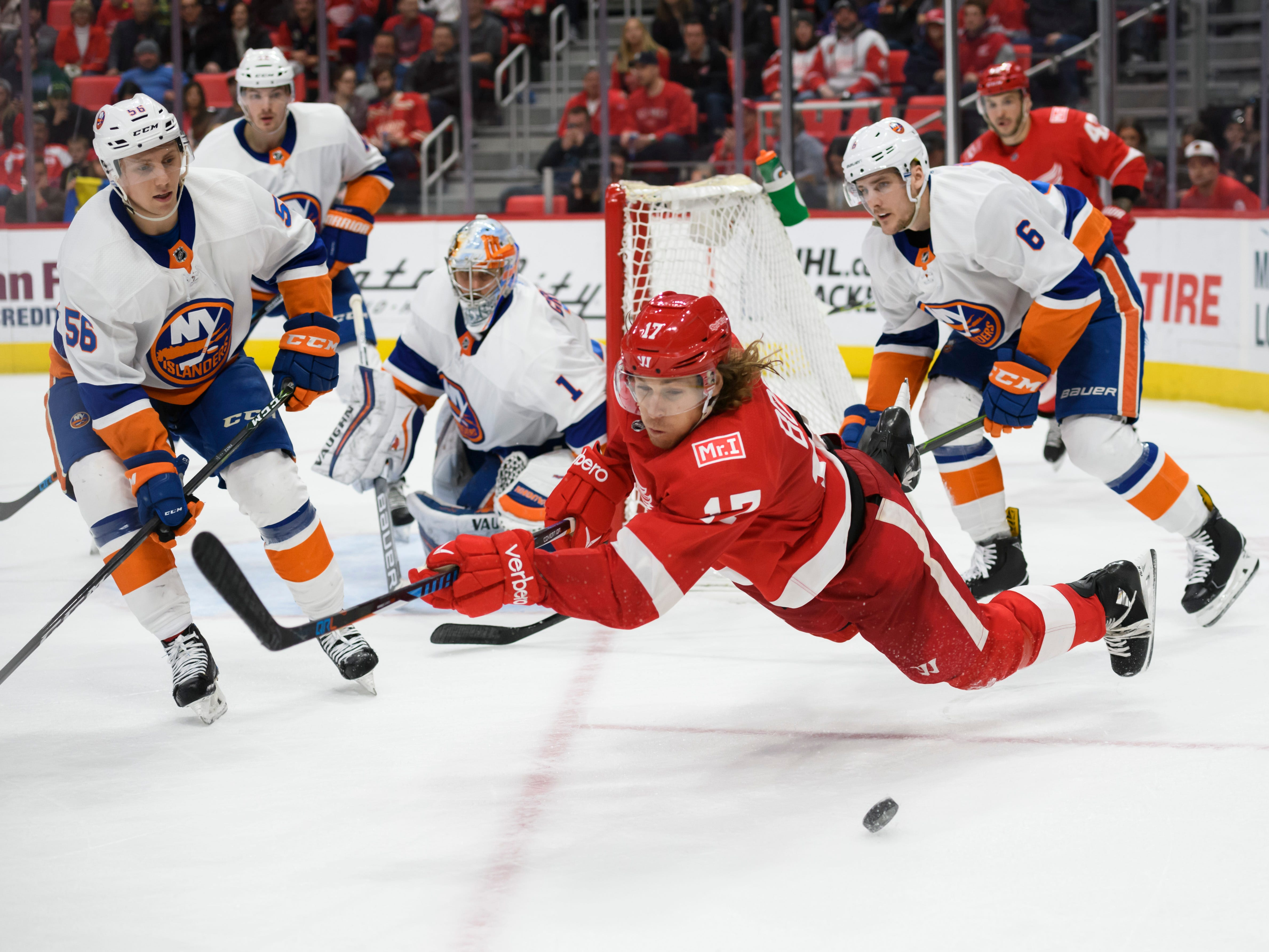 Detroit Red Wings left wing David Booth goes airborne after being tripped up while trying to control the puck against the New York Islanders, at Little Caesars Arena, in Detroit, April 7, 2018. The Wings muddled through a losing 2017-18 season, their first in the new LCA arena.