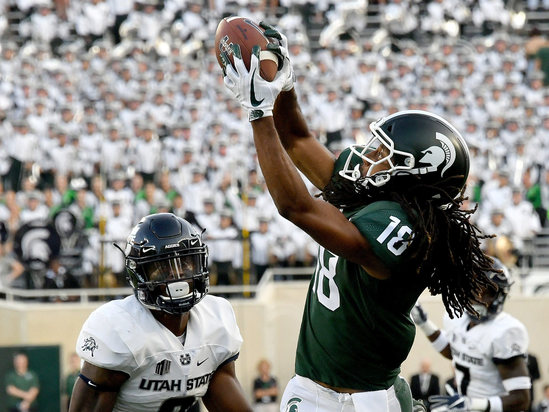 Michigan State WR Felton Davis makes a great catch against Utah State in MSU's season opener at Spartan Stadium in East Lansing on Friday, Aug 31, 2018.  The Spartans finished the 2018 regular season 7-5, fourth in the Big Ten east division. They play Oregon in the Redbox Bowl on Dec. 31st.