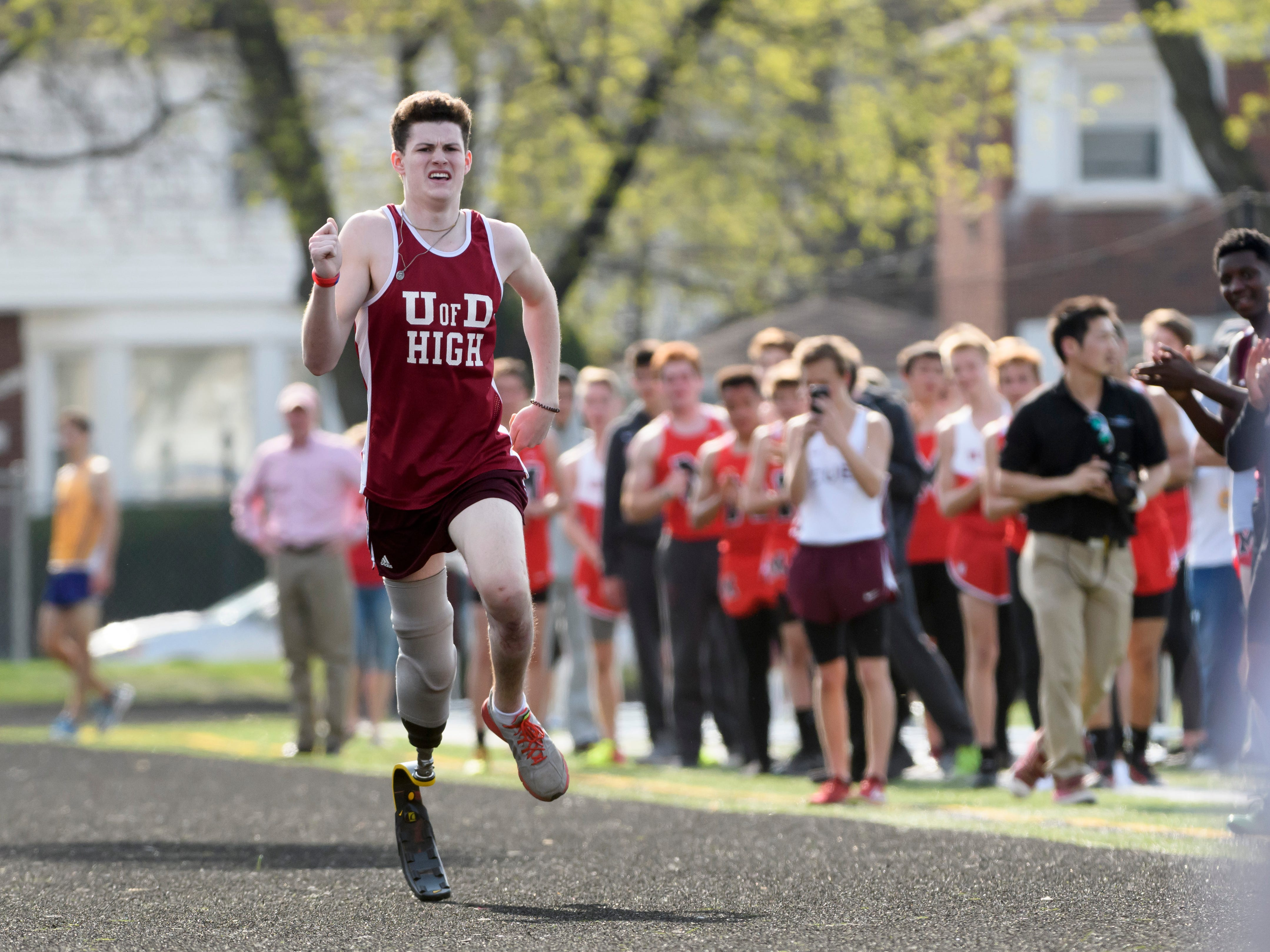 University of Detroit Jesuit High School runner Sean English makes his way down the final straightaway towards the finish line, running his final race, a 400m dash on May 2, 2018.  English lost his leg after being hit by a car while helping at the scene of a rollover accident on I-96 in 2017, but worked hard on rehabbing his shattered leg and became an inspirational hero to his teammates, classmates and the community for his perseverance.