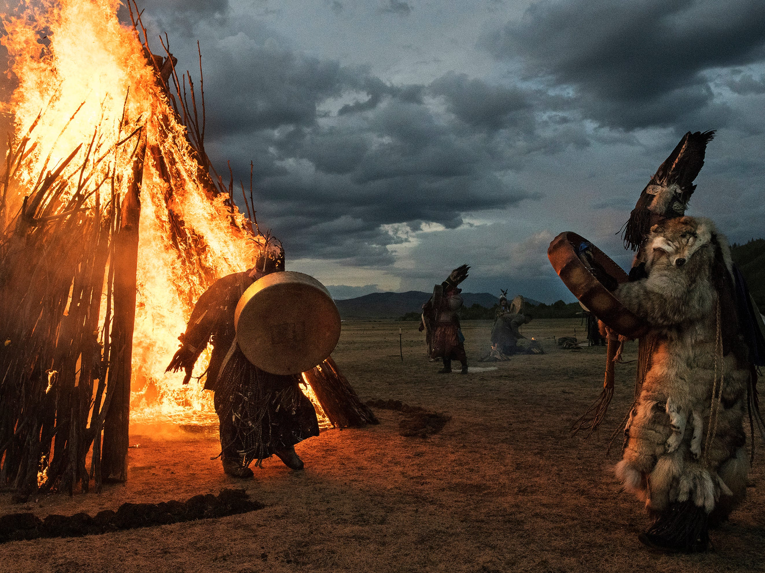 A Mongolian Shaman or Buu, runs as he emerges on fire while taking part with others in a fire ritual meant to summon spirits to mark the period of the Summer Solstice on June 22, 2018 outside Ulaanbaatar, Mongolia. Banned for 70 years under Communist rule, shamanism has seen a resurgence in Mongolia since 1992, when the ancient practice became protected by the country's Constitution. Known as Tengrism, in which Shamans channel ancestral spirits, it is widely regarded as Mongolia's national religion.