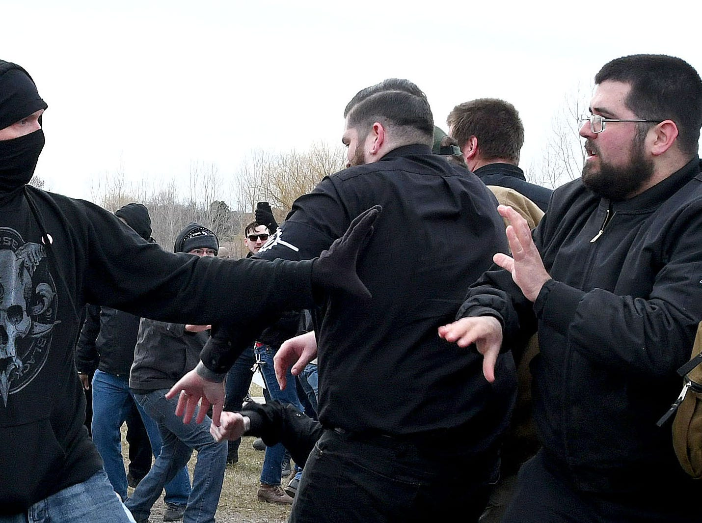 An ANTIFA protester, left, attacks white nationalist Matthew Heimbach, March 5, 2018, during the demonstration outside the MSU Pavilion on the East Lansing campus.  Police estimated 500 people turned out to protest Richard Spencer's speech on campus. When a group of Spencer supporters attempted to march through the crowd, the melee broke out.