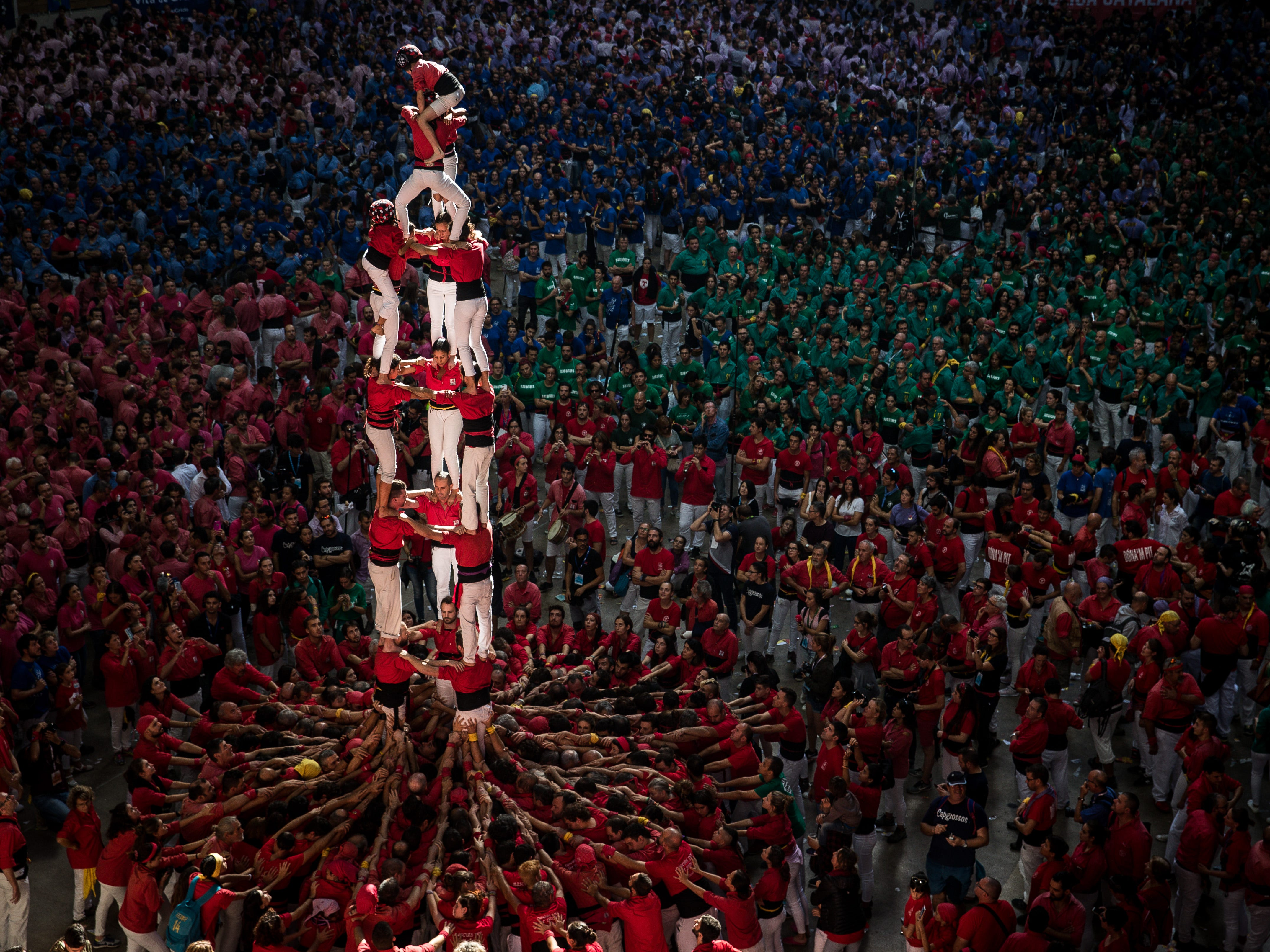 Members of the C. de Barcellona built a human tower during the 27th Tarragona Competition on October 07, 2018 in Tarragona, Spain. The 'Castellers' who build the human towers with precise techniques compete in groups, know as 'colles', aiming to build the highest and most complex human tower. The Catalan tradition is believed to have originated from human towers built at the end of the 18th century by dance groups.