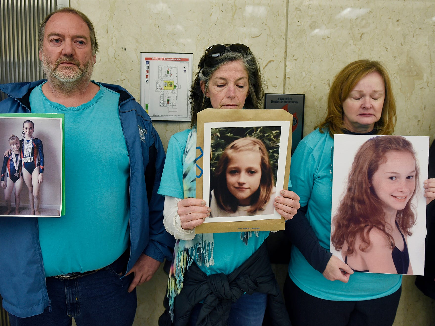 Parents of survivors, from left,  Glen Black of Pinkney, Tammy Bourque-Stemas of Dearborn and Valerie von Frank of Okemos, stand by the elevator waiting for Michigan State trustees to enter the Hannah Admin Building in East Lansing on April 13, 2018. The protesters were demanding the trustee's resignations over the institution's failure to protect women and girls from Dr. Larry Nassar's sexual assaults.
