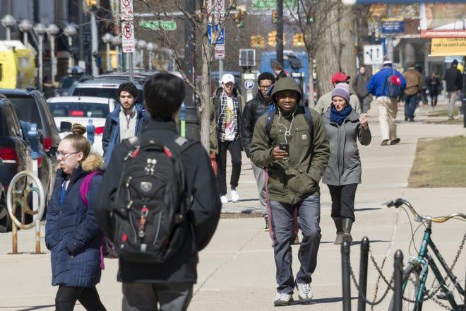Pedestrians on South State Street in Ann Arbor.