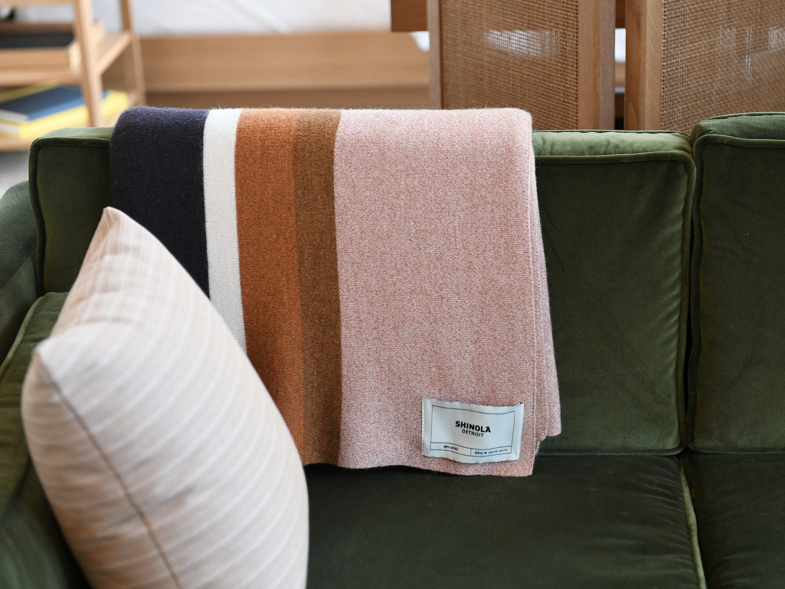 The rooms feature lots of items from Shinola, like this cozy blanket.