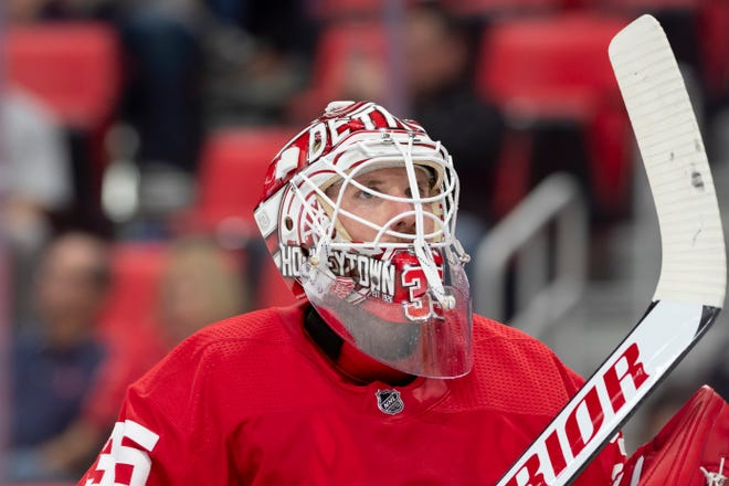 Detroit goalie Jimmy Howard injured his back during warm-ups in Philadelphia and was scratched from his scheduled start.