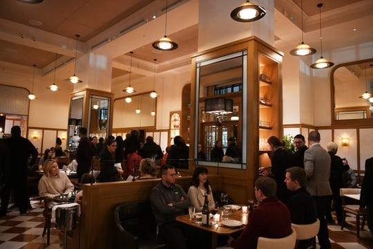 Patrons fill the restaurant the grand opening of San Morello located inside the Shinola Hotel.