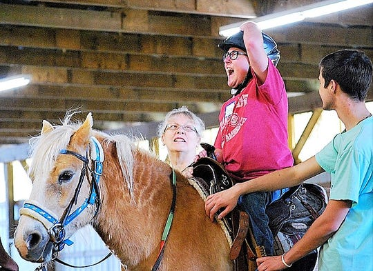 Reins of Hope utilizes trained horses to provide therapeutic riding services to adults and children with special needs.