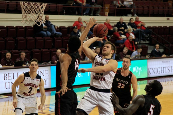 Alex Stein shoots during the University of Southern Indiana's game against Barry University in the Bellarmine Classic at Knights Hall in Louisville, Ky., Wednesday,