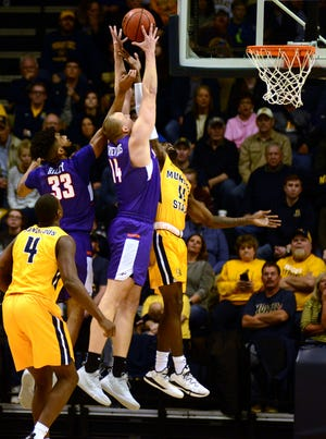 Evansville center Dainius Chatkevicius (14) and K.J. Riley (33) battle for a rebound against Murray State's Shaq Buchanan (11) on Tuesday. The Purple Aces lost, 66-64.