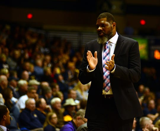 Evansville head coach Walter McCarty reacts from the sidelines during the Purple Aces' 66-64 loss Tuesday at Murray State.