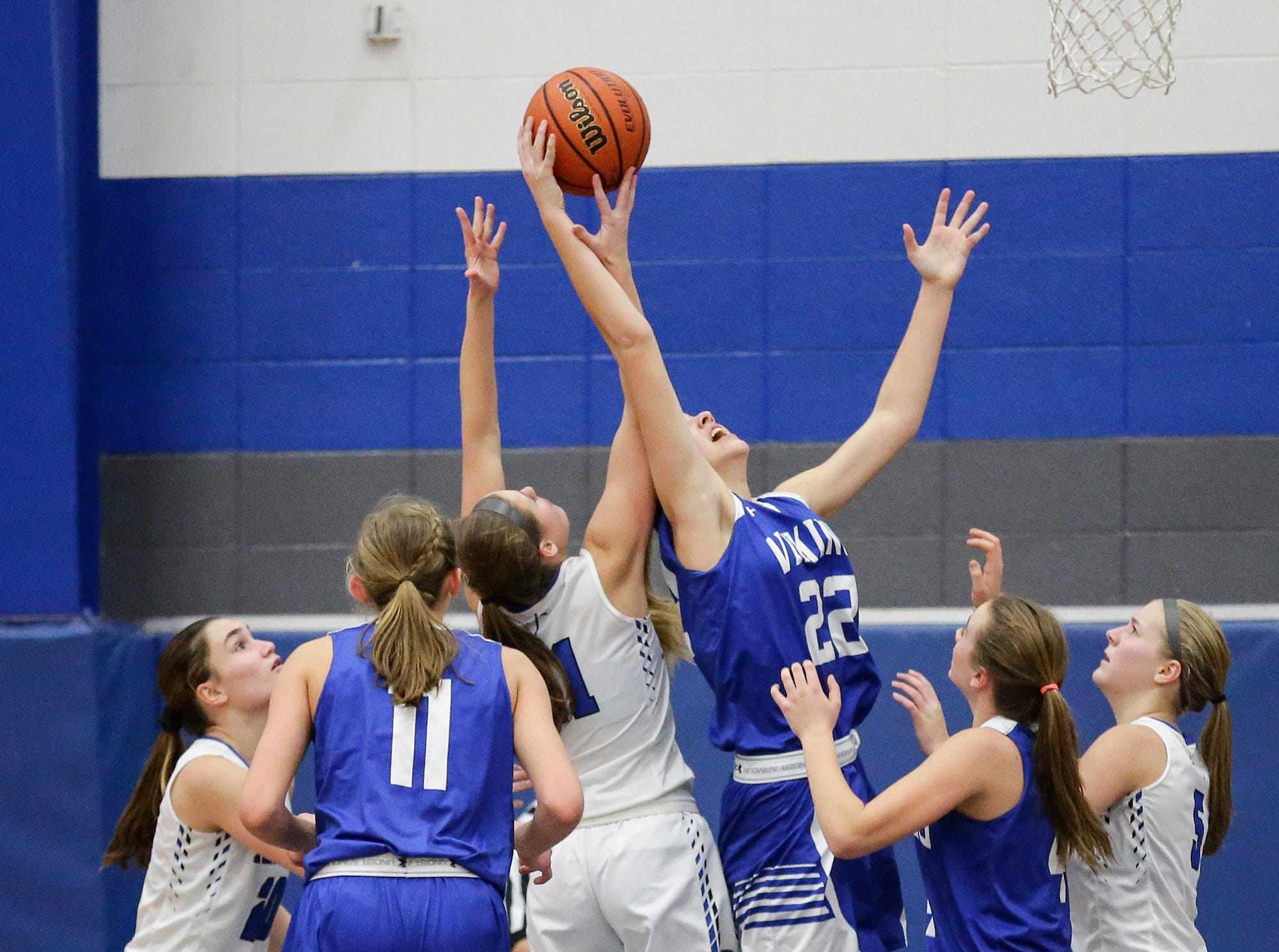 St. Mary's Springs Academy girls basketball's Jennifer Chatterton and Winnebago Lutheran Academy's Kaylee Frey battle for a rebound during their game Tuesday, December 18, 2018 in Fond du Lac. Winnebago Lutheran Academy won the game 58-54. Doug Raflik/USA TODAY NETWORK-Wisconsin