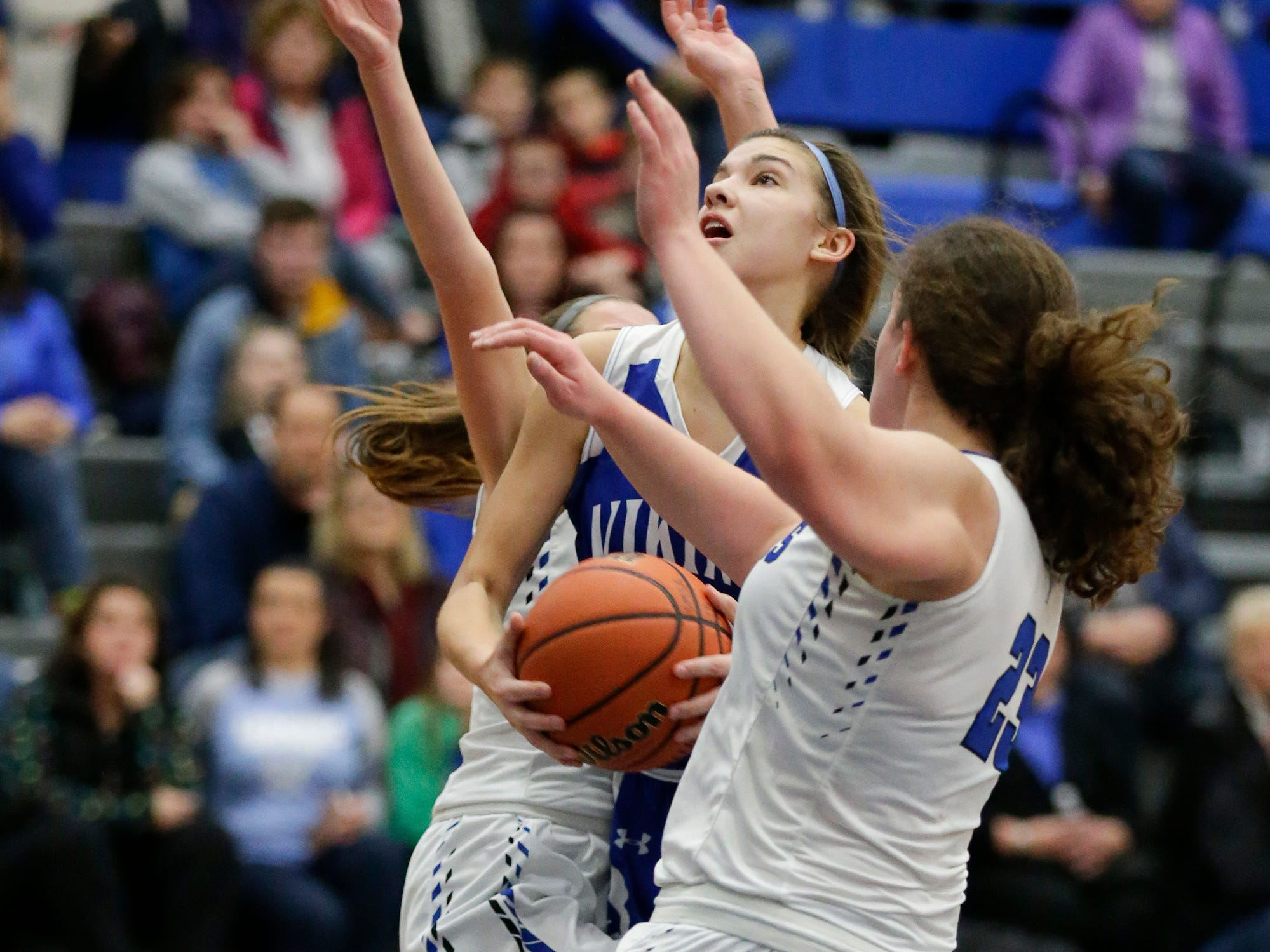 Winnebago Lutheran Academy girls basketball's Kaylee Frey drives in torwards the basket between St. Mary's Springs Academy's Jennifer Chatterton and Cecelia Rodriguez during their game Tuesday, December 18, 2018 in Fond du Lac. Winnebago Lutheran Academy won the game 58-54. Doug Raflik/USA TODAY NETWORK-Wisconsin