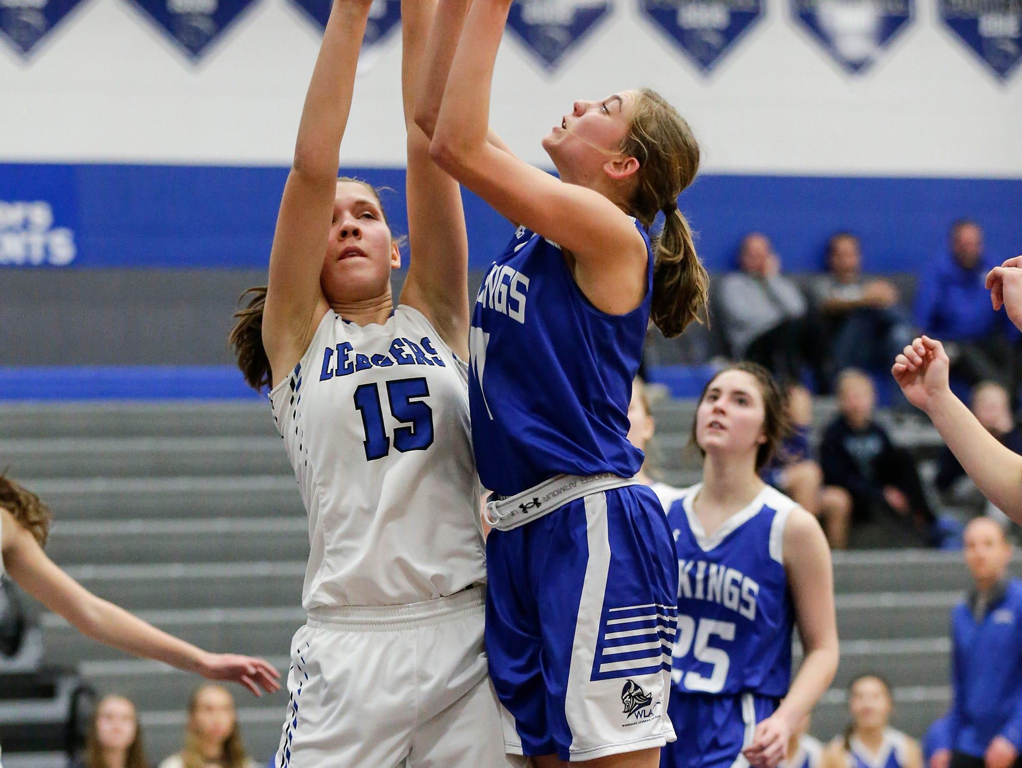 Winnebago Lutheran Academy girls basketball's Alyssa Lorenz goes up for a shot against St. Mary's Springs Academy's Maddie Gehring during their game Tuesday, December 18, 2018 in Fond du Lac. Winnebago Lutheran Academy won the game 58-54. Doug Raflik/USA TODAY NETWORK-Wisconsin