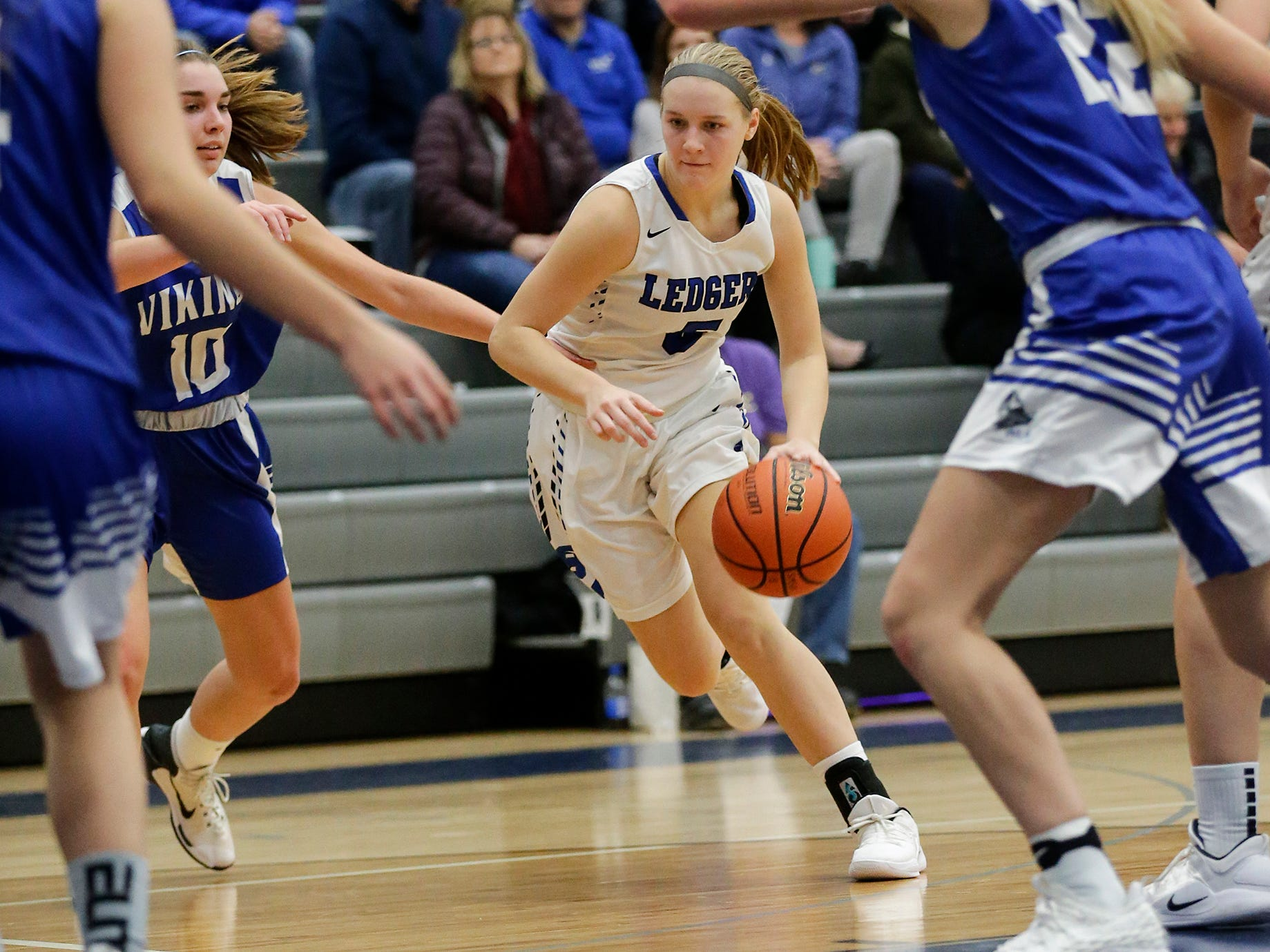 St. Mary's Springs Academy girls basketball's Gracie Rieder dribbles the ball against Winnebago Lutheran Academy during their game Tuesday, December 18, 2018 in Fond du Lac. Winnebago Lutheran Academy won the game 58-54. Doug Raflik/USA TODAY NETWORK-Wisconsin