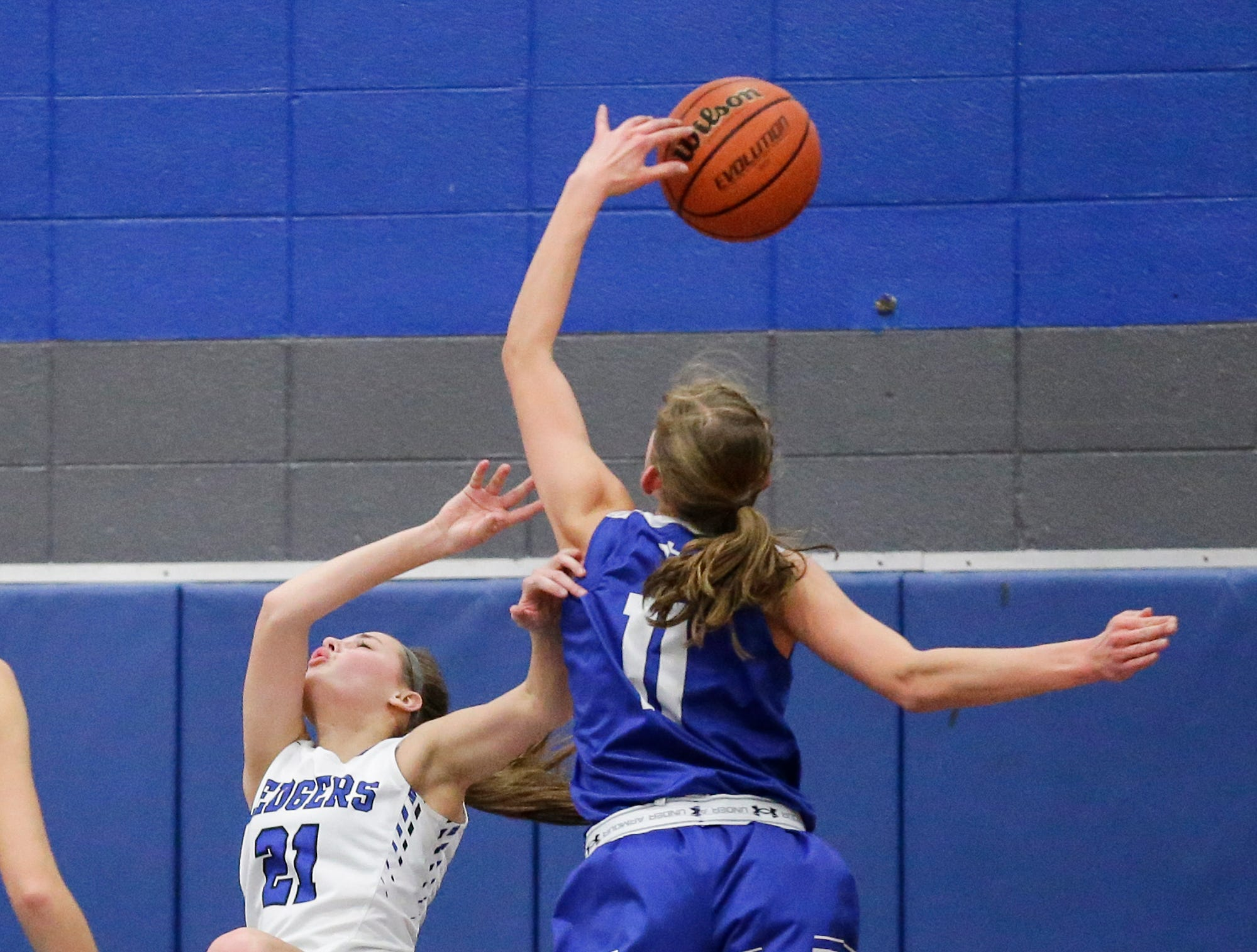 St. Mary's Springs Academy girls basketball's Jennifer Chatterton gets fouled by Winnebago Lutheran Academy's Alyssa Lorenz during their game Tuesday, December 18, 2018 in Fond du Lac. Winnebago Lutheran Academy won the game 58-54. Doug Raflik/USA TODAY NETWORK-Wisconsin
