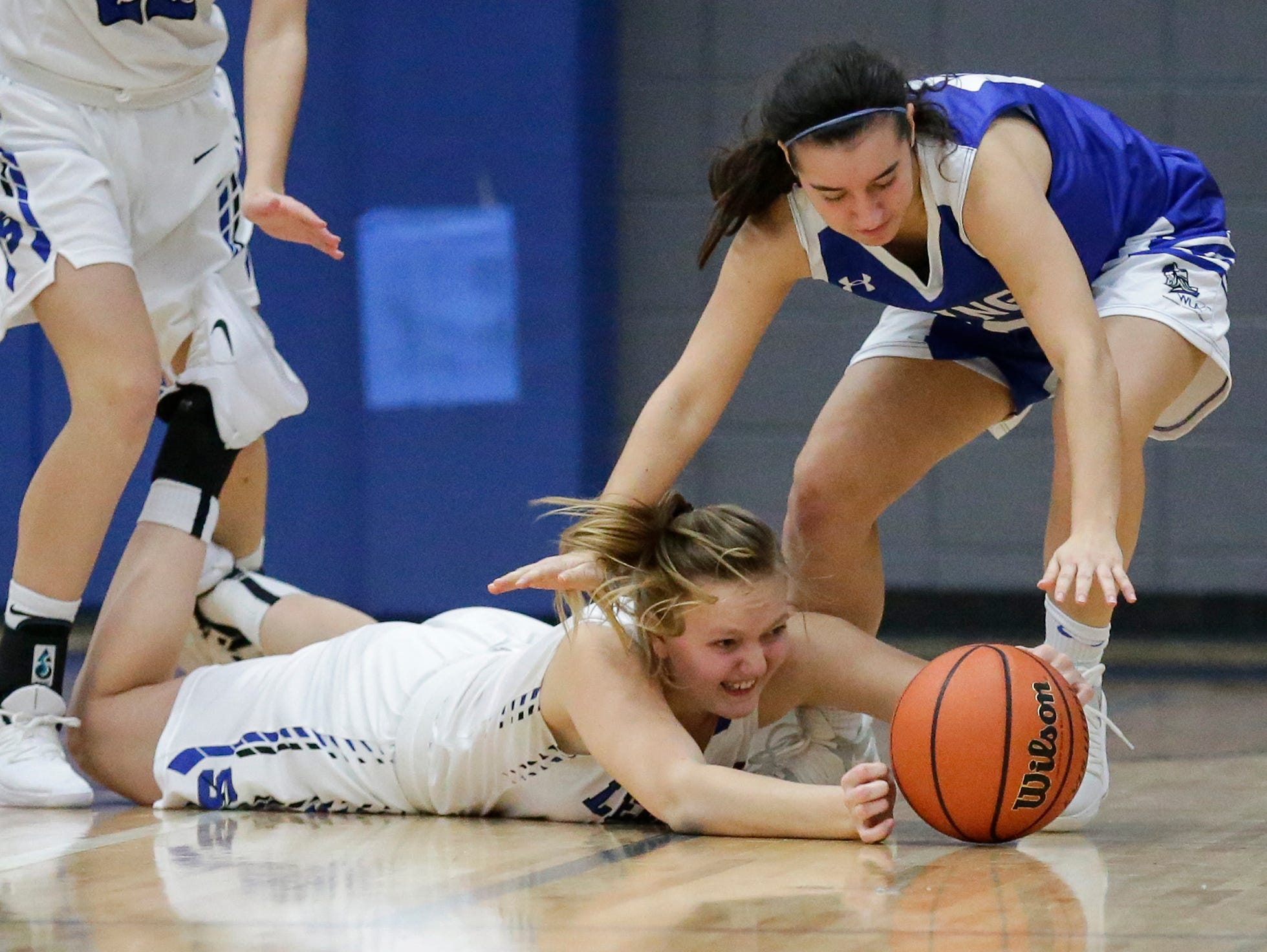St. Mary's Springs Academy girls basketball's Brianna Freund and Winnebago Lutheran Academy's Katelyn Bonilla battle for a loose ball during their game Tuesday, December 18, 2018 in Fond du Lac. Winnebago Lutheran Academy won the game 58-54. Doug Raflik/USA TODAY NETWORK-Wisconsin