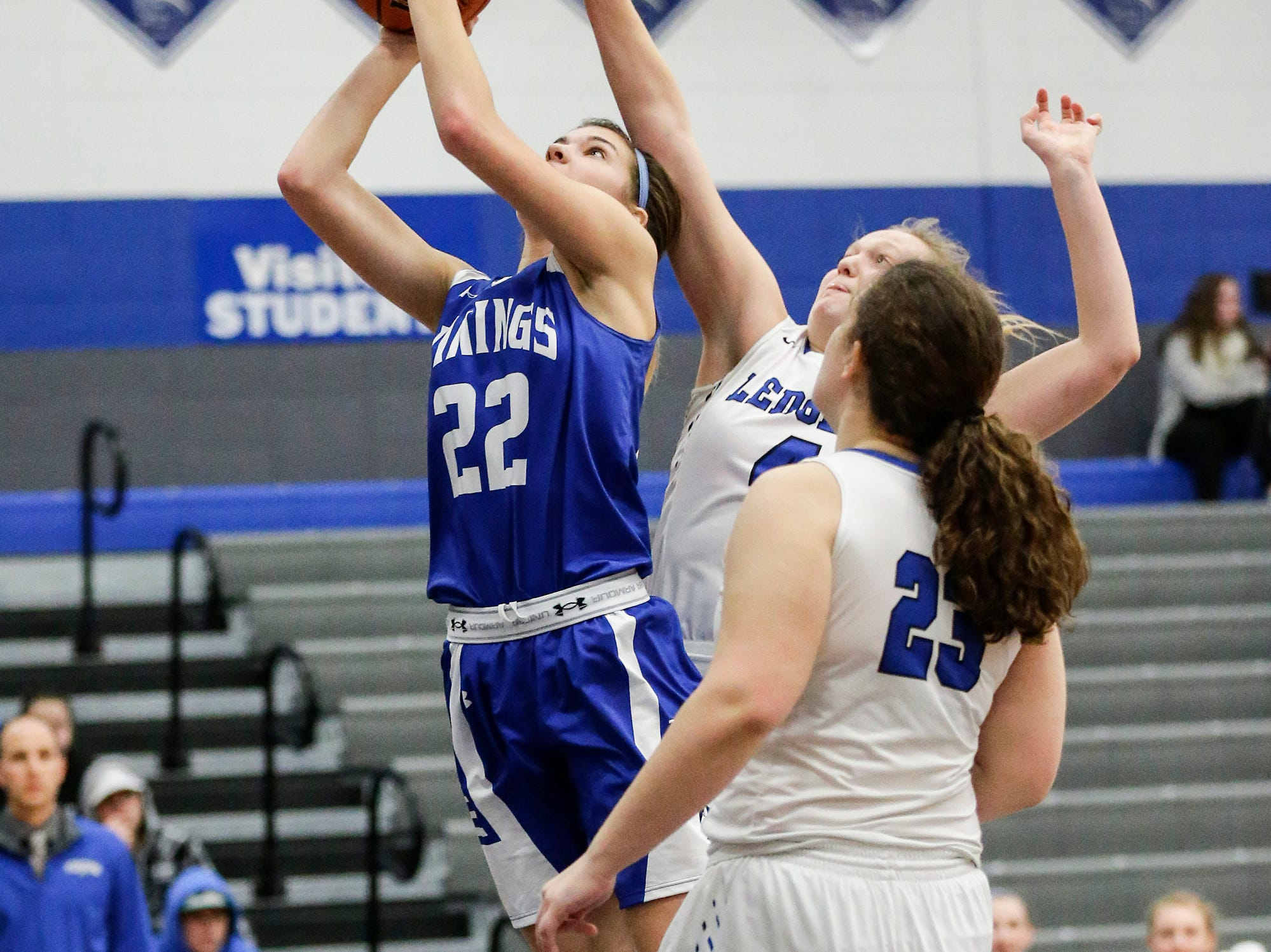 Winnebago Lutheran Academy girls basketball's Kaylee Frey goes up for a shot against St. Mary's Springs Academy's Brianna Freund during their game Tuesday, December 18, 2018 in Fond du Lac. Winnebago Lutheran Academy won the game 58-54. Doug Raflik/USA TODAY NETWORK-Wisconsin