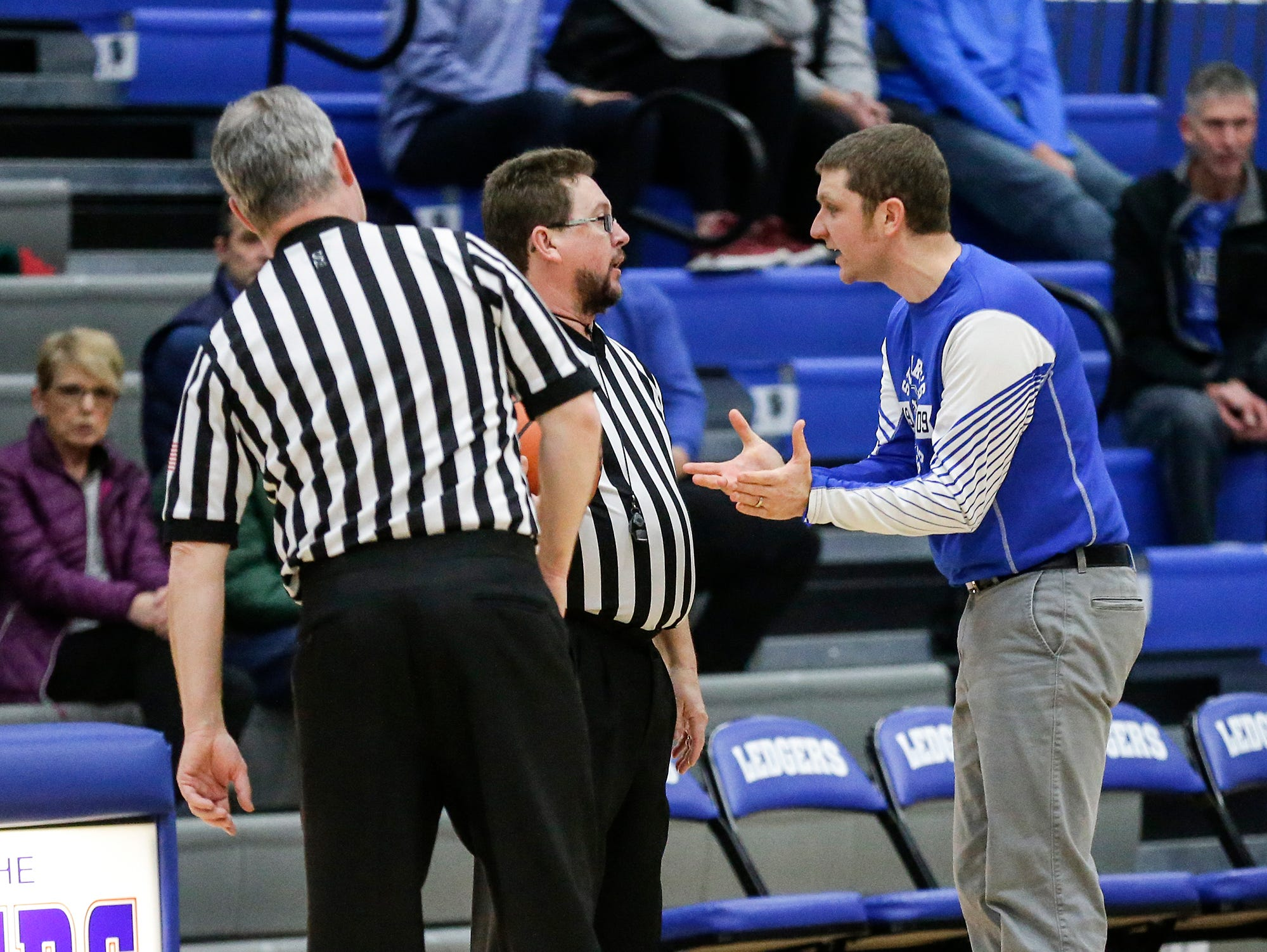 St. Mary's Springs Academy girls basketball coach Mitch Redig questions a call from a referee during their game against Winnebago Lutheran Academy Tuesday, December 18, 2018 in Fond du Lac. Winnebago Lutheran Academy won the game 58-54. Doug Raflik/USA TODAY NETWORK-Wisconsin