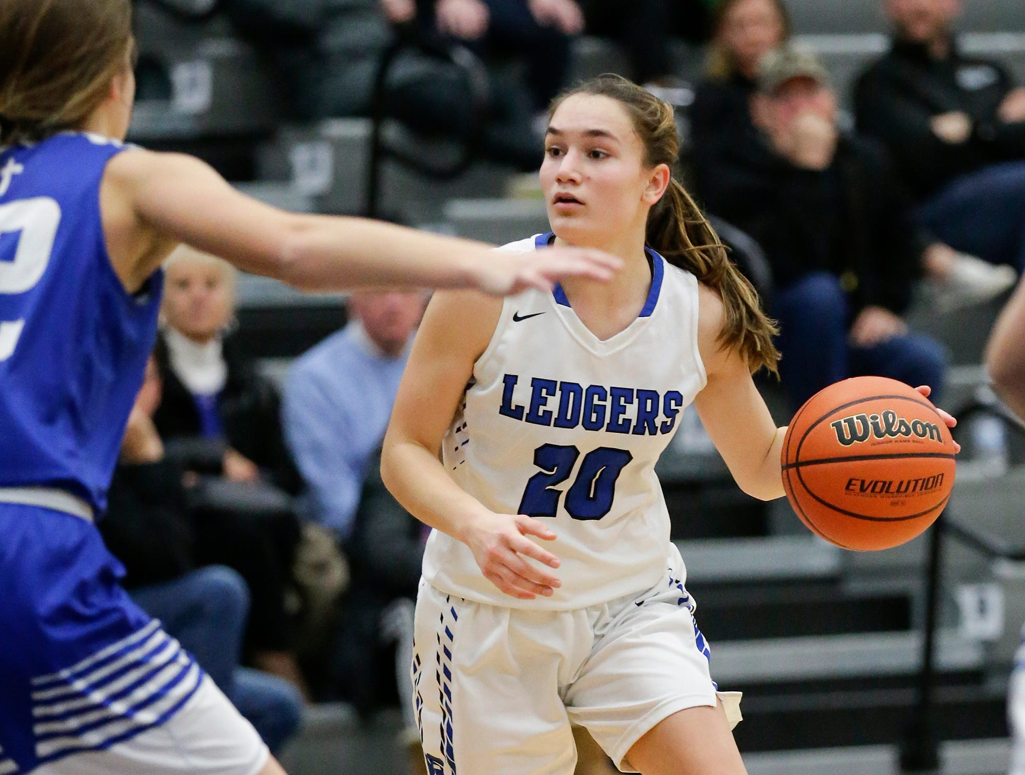 St. Mary's Springs Academy girls basketball's Jenna Gilgenbach dribbles the ball against Winnebago Lutheran Academy during their game Tuesday, December 18, 2018 in Fond du Lac. Winnebago Lutheran Academy won the game 58-54. Doug Raflik/USA TODAY NETWORK-Wisconsin