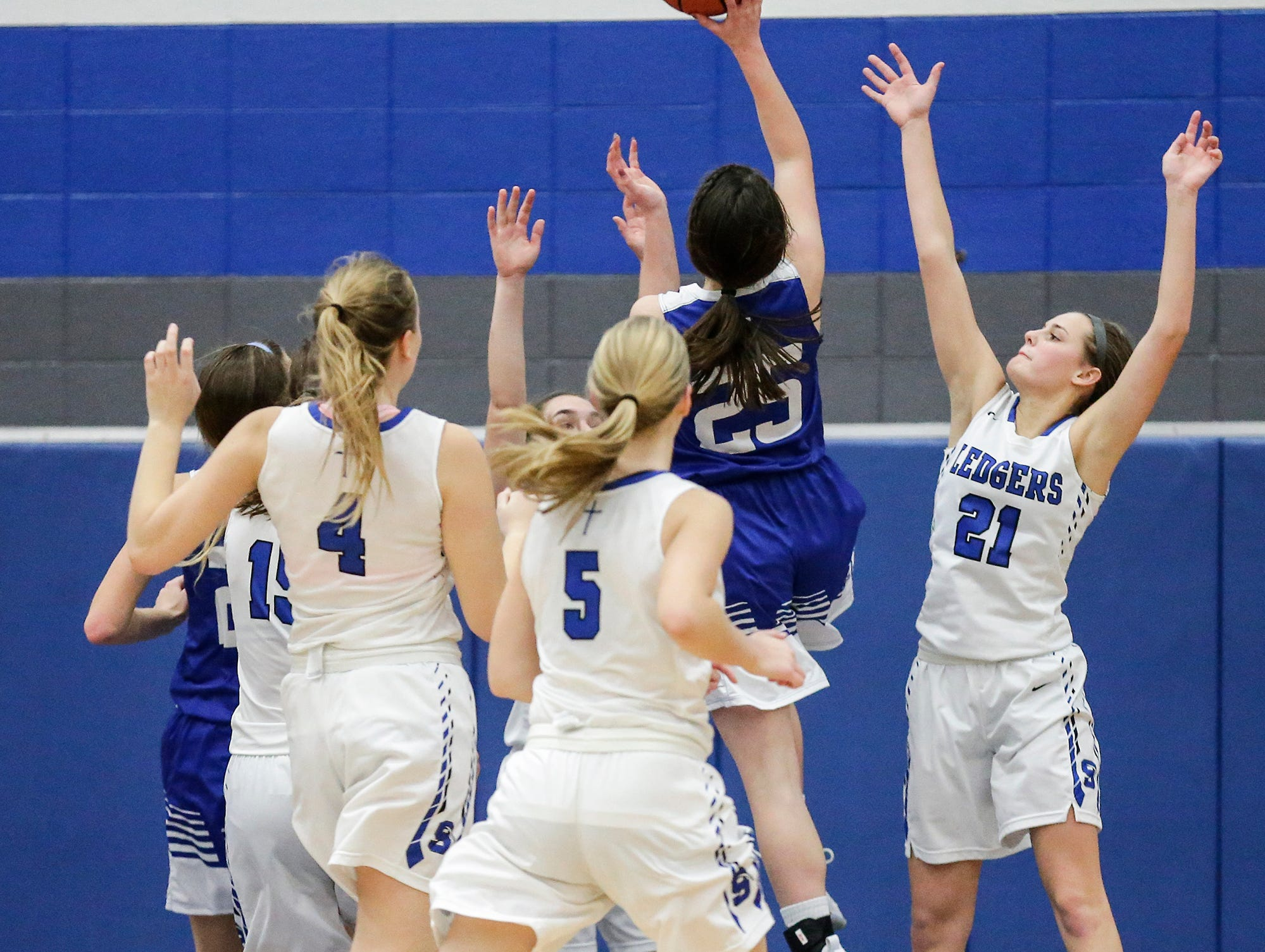 Winnebago Lutheran Academy girls basketball's Geneva Hewitt goes up for a basket against St. Mary's Springs Academy during their game Tuesday, December 18, 2018 in Fond du Lac. Winnebago Lutheran Academy won the game 58-54. Doug Raflik/USA TODAY NETWORK-Wisconsin