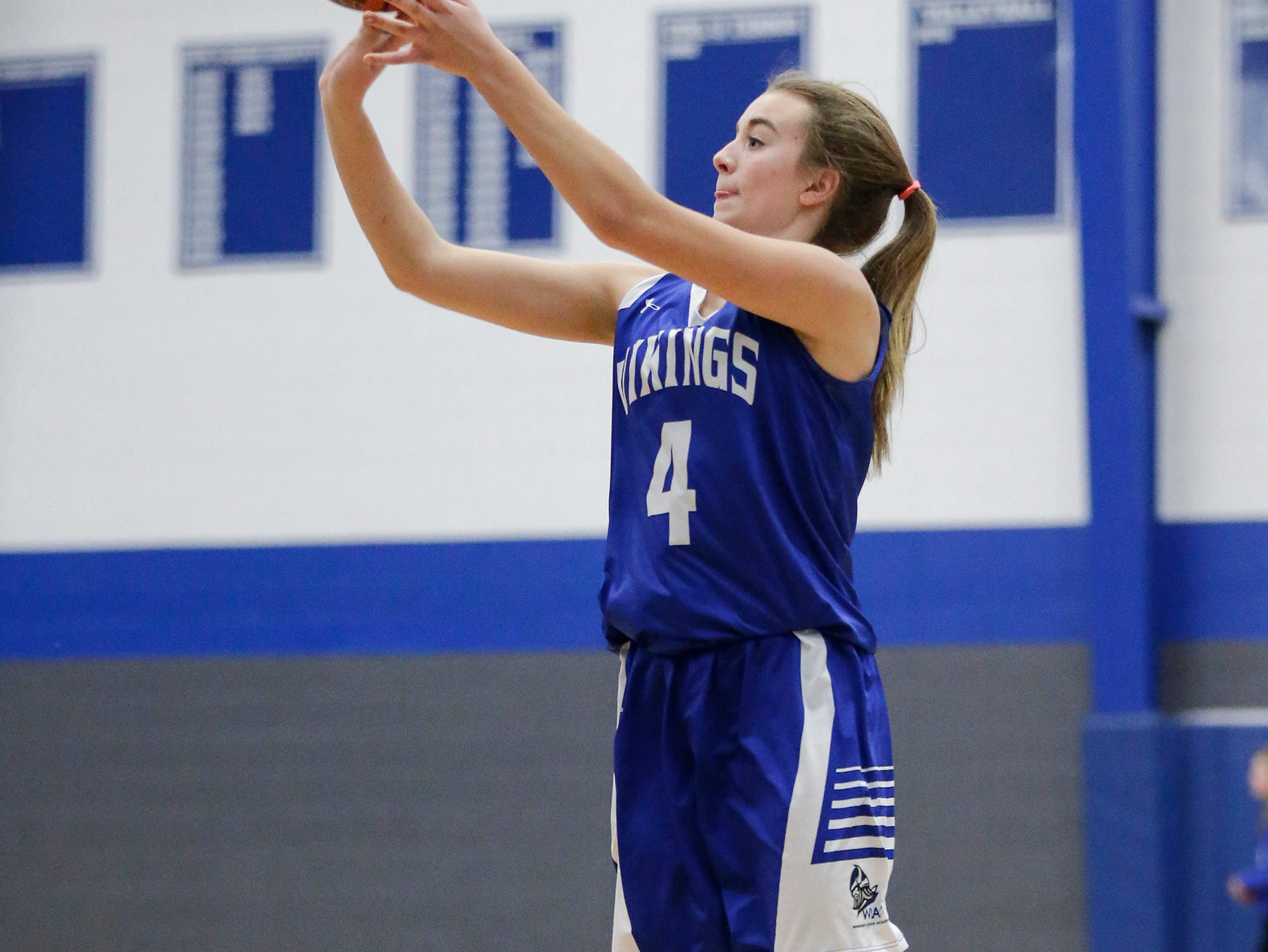 Winnebago Lutheran Academy girls basketball's Rylee Loehr shoots a three pointer against St. Mary's Springs Academy during their game Tuesday, December 18, 2018 in Fond du Lac. Winnebago Lutheran Academy won the game 58-54. Doug Raflik/USA TODAY NETWORK-Wisconsin
