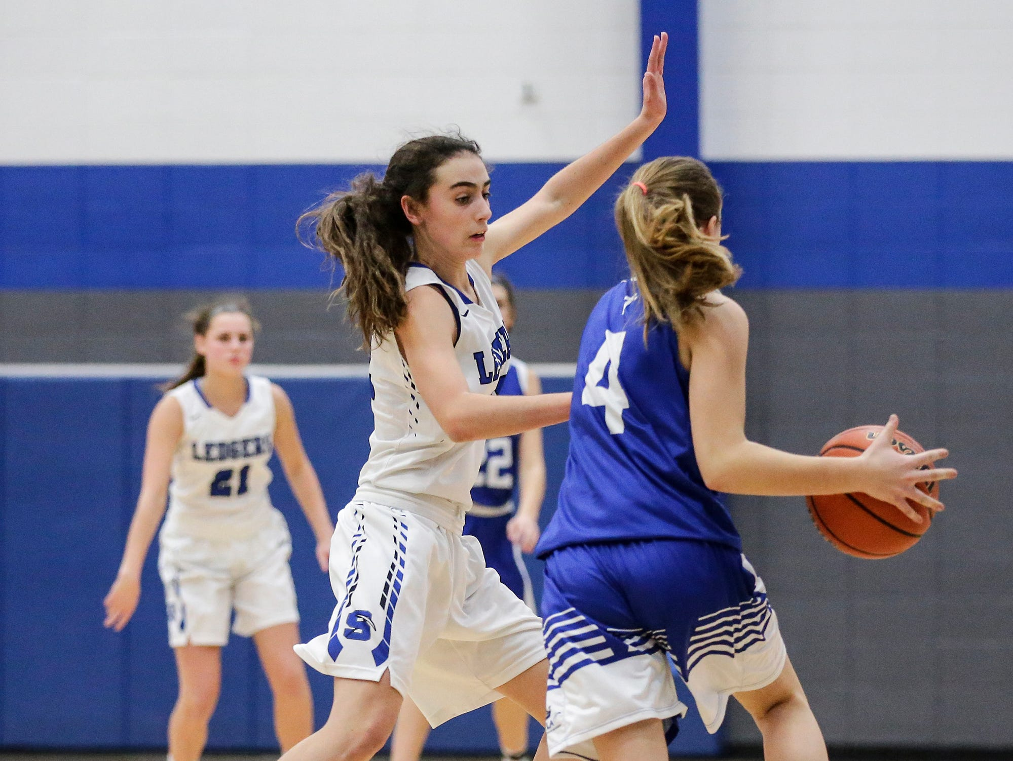 St. Mary's Springs Academy girls basketball's Isabelle Coon defends against Winnebago Lutheran Academy's Rylee Loehr during their game Tuesday, December 18, 2018 in Fond du Lac. Winnebago Lutheran Academy won the game 58-54. Doug Raflik/USA TODAY NETWORK-Wisconsin