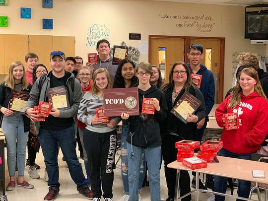 "The Independent Living class shows off the cards and candy canes they will distribute as an of taking care of others, or ""TCO'D."" The project was a partnership between the class and Life Enforcement."