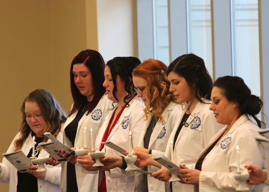 Nursing School graduates recite the Nightengale Pledge at the Terra State Community College pinning ceremony.