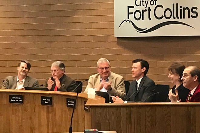 The Fort Collins City Council applauds outgoing Council member Bob Overbeck. Overbeck won election to Larimer County Assessor in November and is giving up his Council seat as a result.