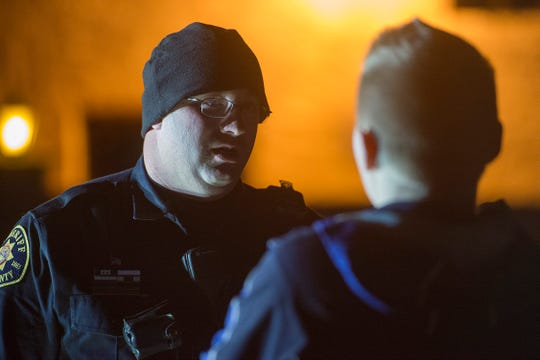 Deputy Sam Roth talks with a person suspected of driving under the influence near Old Town in the early morning hours of Saturday, December 15, 2018.