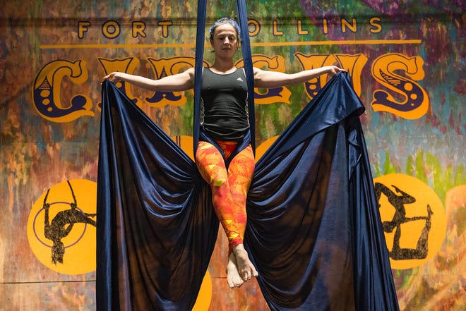 Jessica Schultz is suspended in the air as she shows off her skills on aerial silks at the Fort Collins Circus Center on Tuesday December 18, 2018.