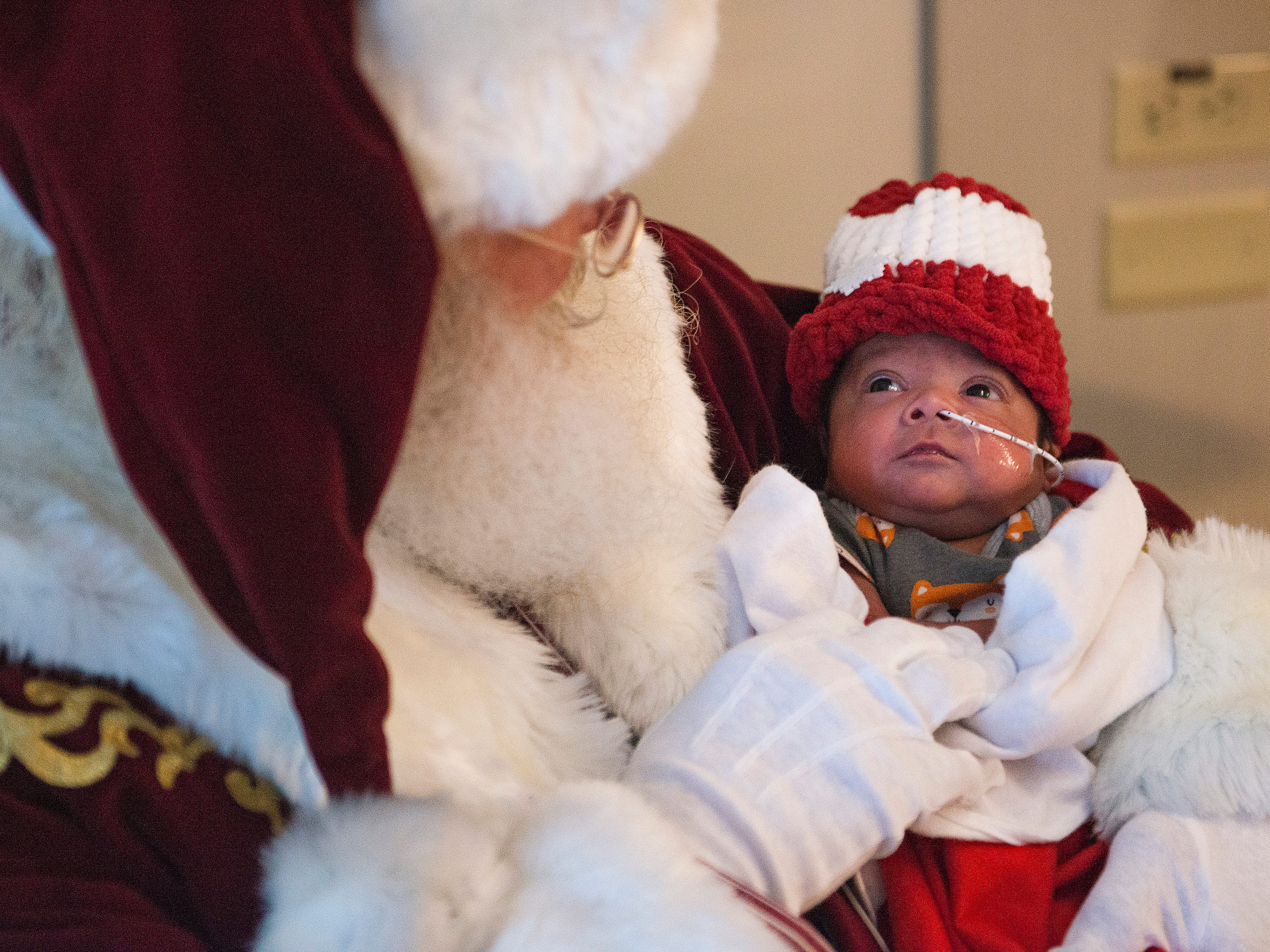 Santa Claus, portrayed by Moose Shattuck, holds Abraham Kong as he visits the neonatal intensive care unit at Poudre Valley Hospital on Tuesday December 18, 2018.