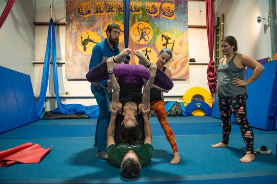 Sean Kirkpatrick and Jessica Schultz help Krista Lockwood and Randy Price with an AcroyYoga pose at the Fort Collins Circus Center on Tuesday December 18, 2018.