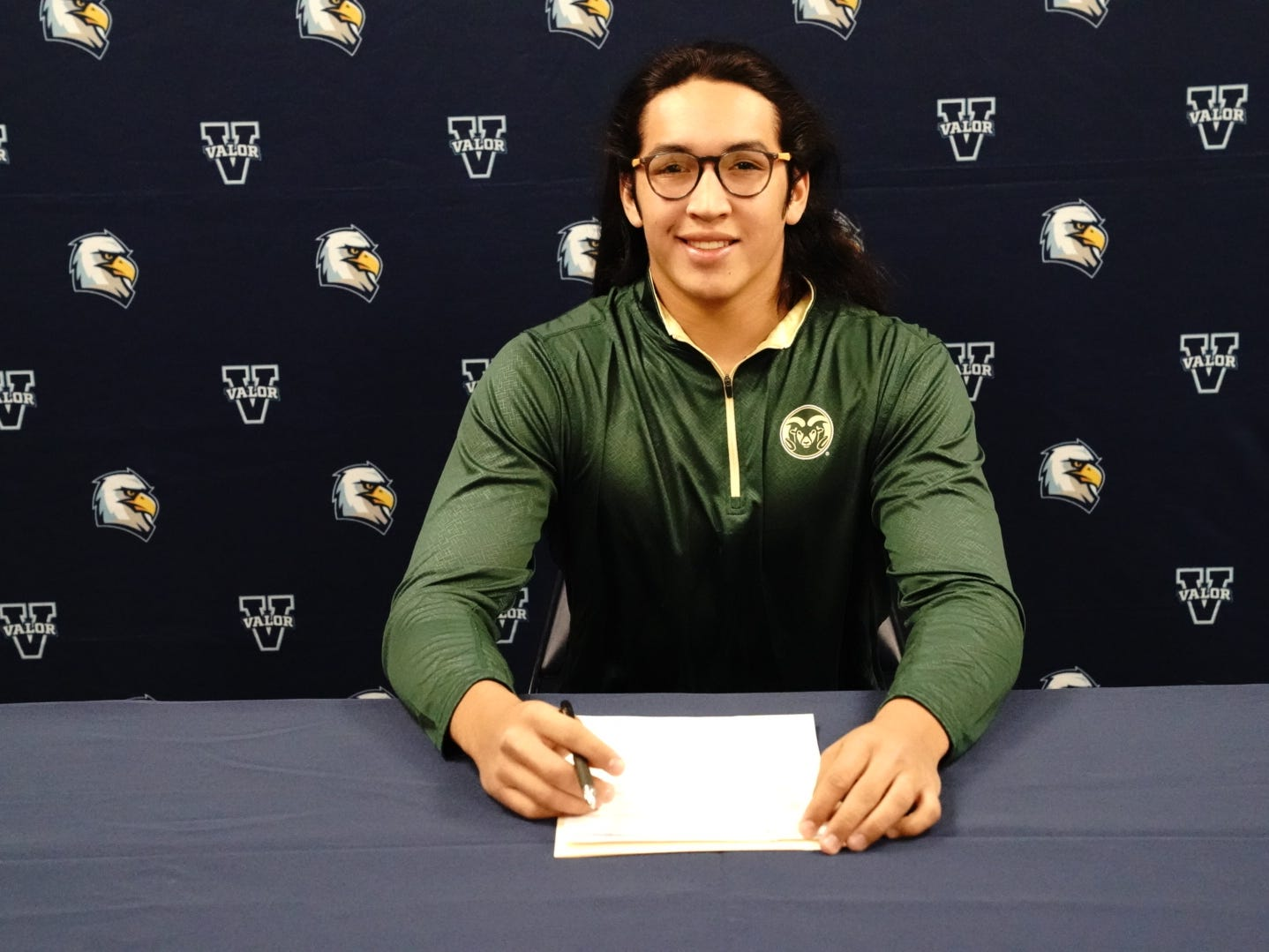 Valor Christian defensive end Cian Quiroga at his signing ceremony to become a CSU football player.