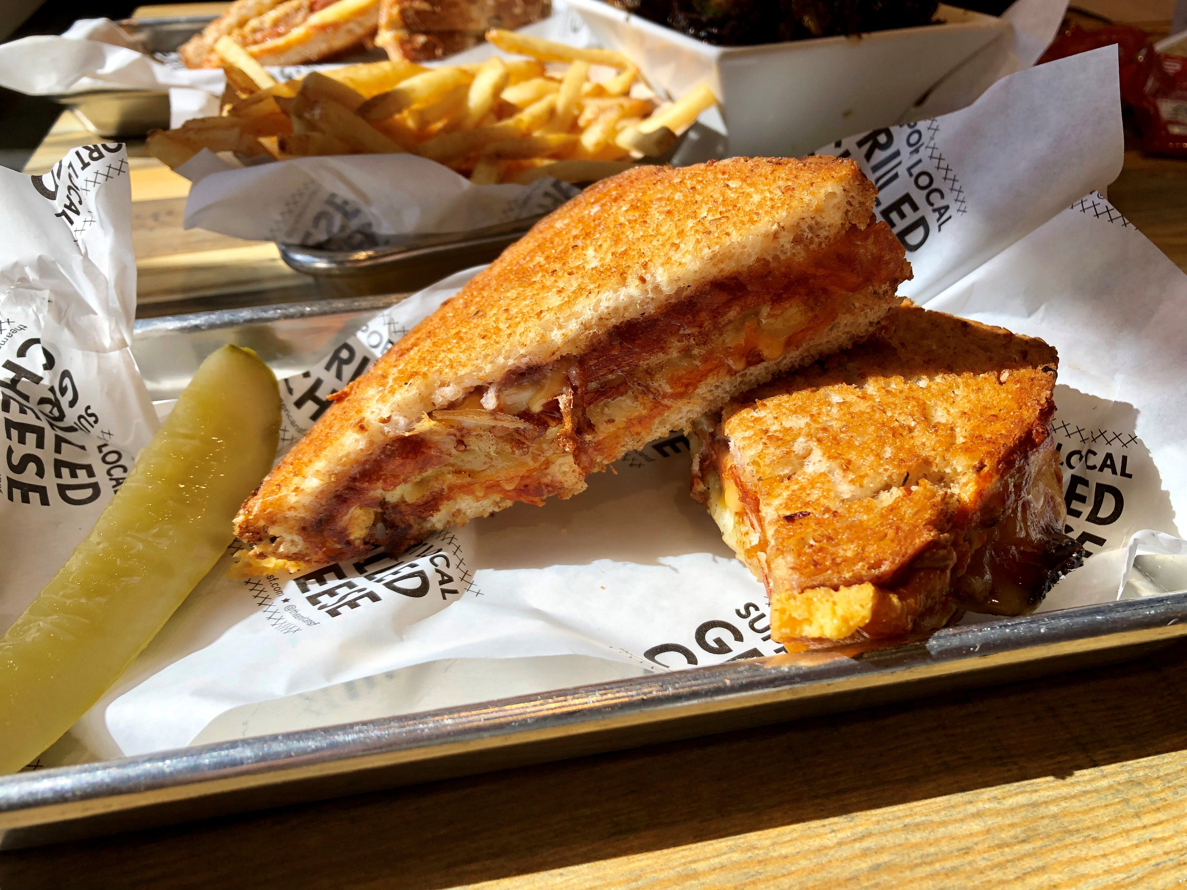 A holiday special grilled cheese made with turkey, stuffing, mashed potatoes, cranberry sauce and gravy from The American Grilled Cheese Kitchen.