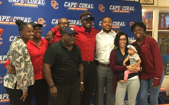Cape Coral High defensive end Tre'Shaun Clark poses with family after signing with Liberty University on Wednesday, Dec. 19, 2018.