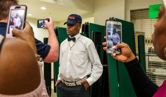 Major Williams is interviewed after signing with Virginia. Family members got in on it as well. Dunbar held its signing ceremony in the cafeteria for 3 football players. Derick Hunter, picked Texas A&M, Seneca Milledge, a long time commit to Virginia, as well as Major Williams, joining his teammate in Virginia