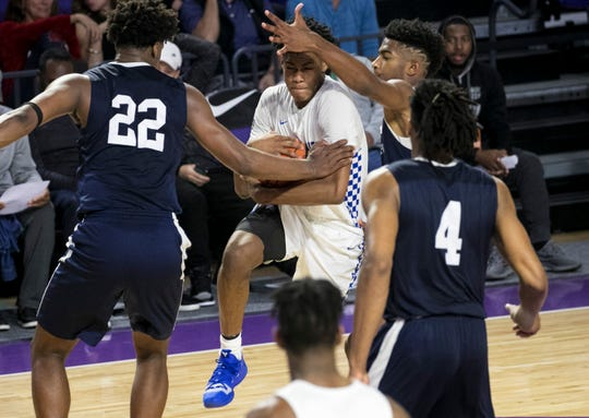 Cam'ron Fletcher of Vashon High School  is surrounded by University School defenders at City of Palms Classic on Tuesday, Dec. 18, 2018. Fletcher is rated No. 45 on the ESPN 100 and 247Sports for the Class of 2020.