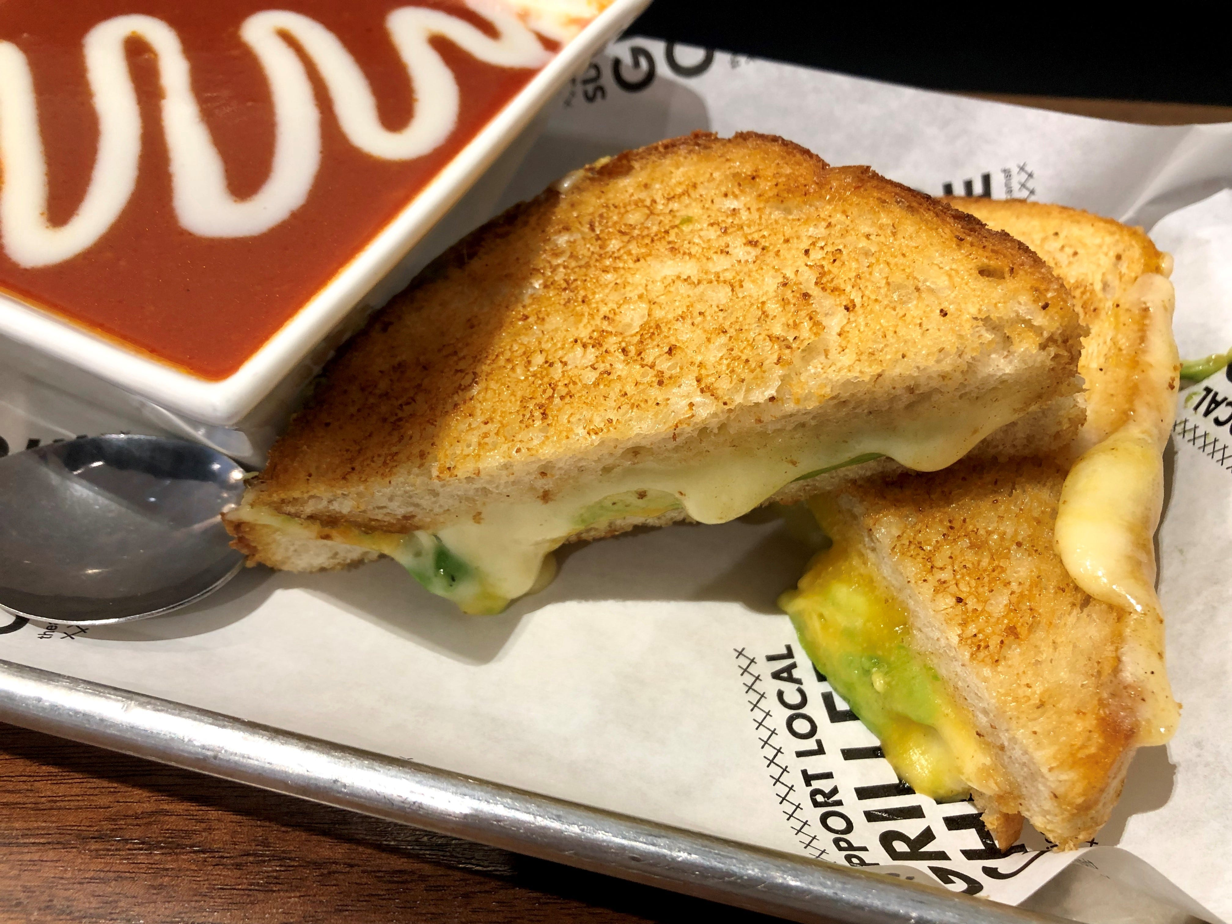 The American Grilled Cheese Kitchen's classic Mousetrap sandwich is made with Tillamook cheddar, Monterey jack and havarti on sourdough. You can avocado for $1.50.