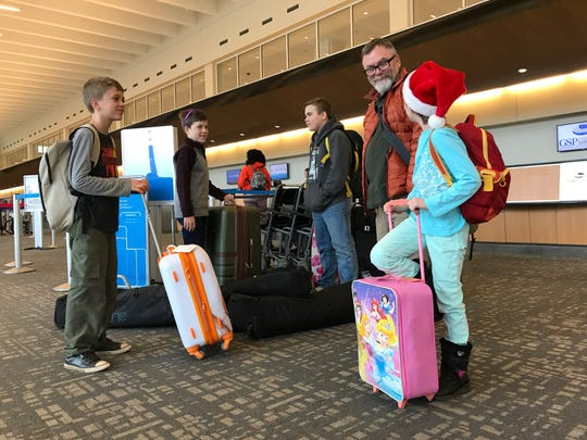 From left, Canyon Gittings, Arden Gittings, Carl Gittings Jr., Carl Gittings Sr. and Everleigh Gittings of Asheville prepare for a flight at GSP International to Albuquerque on Wednesday, Dec. 19, 2018. The family is visiting family in New Mexico and say they drove to Greenville for their flight because the rates are more reasonable here.