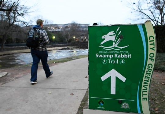 Part of the Swamp Rabbit Trail runs through Falls Park on the Reedy in Greenville Wednesday, Dec. 19, 2018.