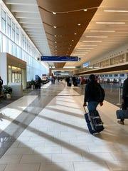 Airline passengers make their way through GSP International Airport on Wednesday, Dec. 19, 2018.