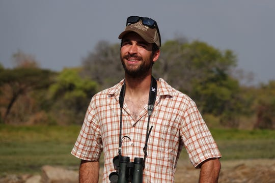 Chase Dart of Great Falls works as a field ecologist in Zambia, monitoring lions and wild dogs populations.