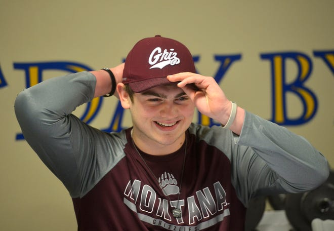 Great Falls Central football star Noah Ambuehl signed his official papers with the University of Montana on Tuesday. Ambuehl led the Mustangs to the Class C state championship game this season.