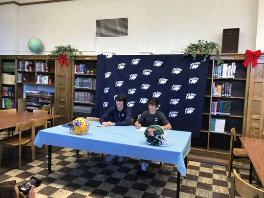Great Falls High football stars Blake Thelen, left, and Kyle Torgerson signed official papers on Wednesday with Montana State and Montana Tech, respectively.